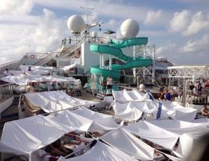 Passengers aboard the fire-damaged Carnival Triumph cruise ship set up a makeshift tent city on the vessel's deck.